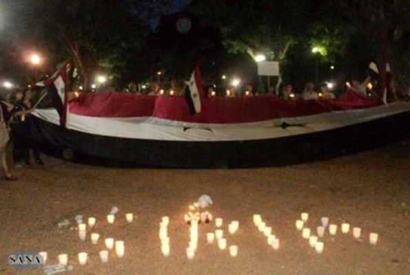 Syrian community in Argentina hold candle light march in support of Motherland