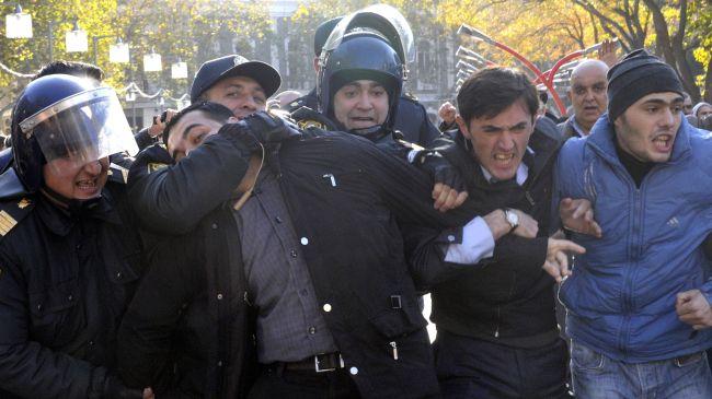 Photo of Azeri riot police detain dozens of anti-govt. demonstrators