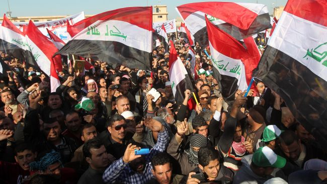 Photo of Demonstrators rally in support of Iraqi government