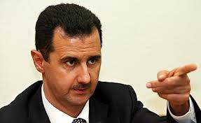 "Photo of Assad to neighboring countries:""Strong Syrians will never forget your crimes"""
