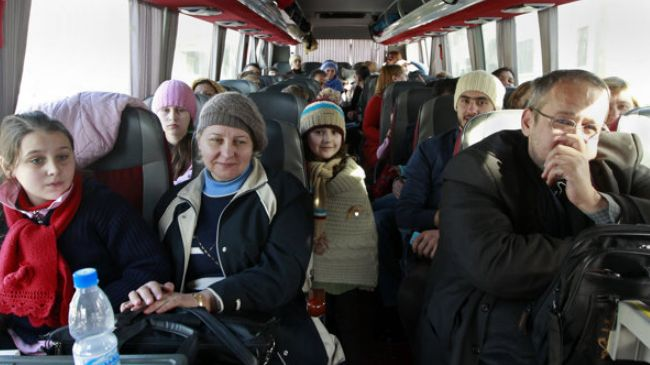 Photo of Dozens of Russians in Syria return home