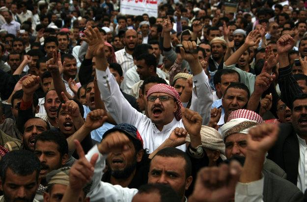 Yemeni men chant slogans as they rally o