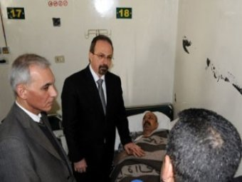 Photo of Syrian Minister of Health visits the wounded of al-Thawra explosion