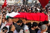 Photo of Bahrainis rally over protester's body