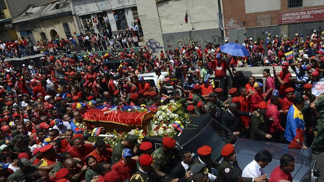 Hugo Chavez lies in open casket for farewell
