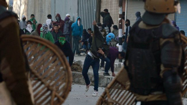 Indian police, protesters clash in Kashmir