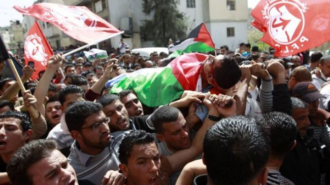 Palestinians hold funeral for man shot by Israeli troops