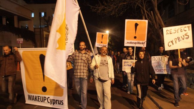Cypriot protesters burn EU flags over bailout deal