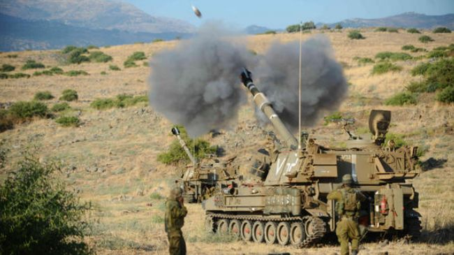 Photo of Zionist Slaughterer Israel shells Syria side of Golan Heights