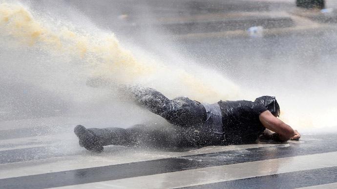 Photo of Ankara police block activist funeral cortege, raid memorial protest with poisonous tear gas