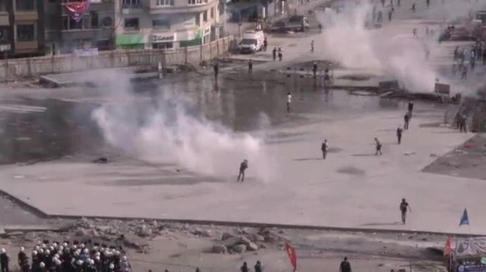 Photo of Turkish police use water cannons, tear gas to oust protesters from Taksim Square