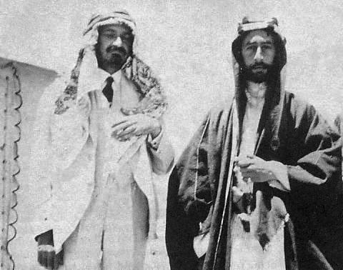 Photo of Photo- 1918. Emir Faisal I and Chaim Weizmann,who became Israel's first President (left, wearing Arab headdress as a sign of friendship)