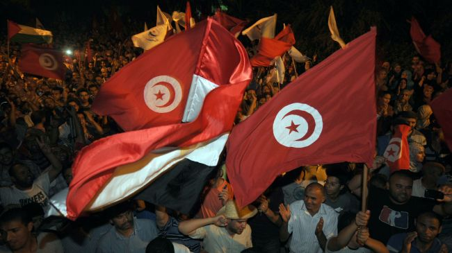 Photo of Tunisian lawmakers join protests against killing of opposition figure