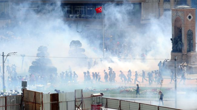 Photo of Turkish police fire tear gas at protesters in Istanbul