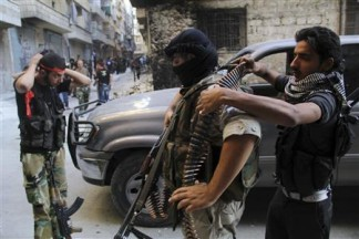 Free Syrian Army fighters prepare for an offensive against forces loyal to Syria's President Bashar al-Assad, in Aleppo's Salaheddine neighborhood