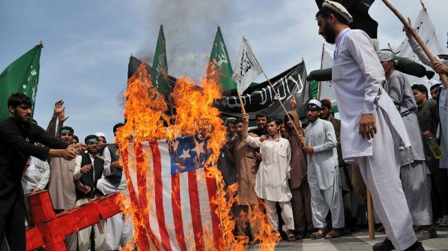 Photo of Afghan workers stage protest against US company