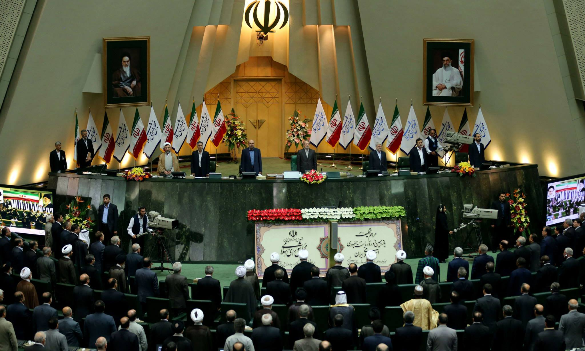 Photo of Photos- Iran's President Hasan Rowhani delivers a speech after being sworn in before parliament in Tehran on August 4, 2013