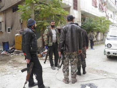 Free Syrian Army fighters are seen in the Al-khalidiya neighbourhood of Homs