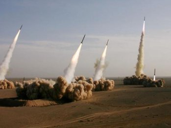 Iran test fires 14 missiles