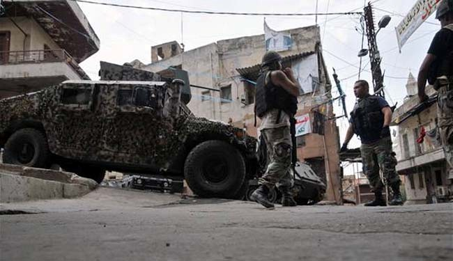 Photo of Lebanese troops hurt in Tripoli clashes