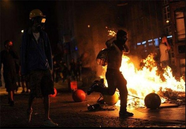 Photo of Protestors Clash with Turkish Riot Policemen at Kadikoy in Istanbu