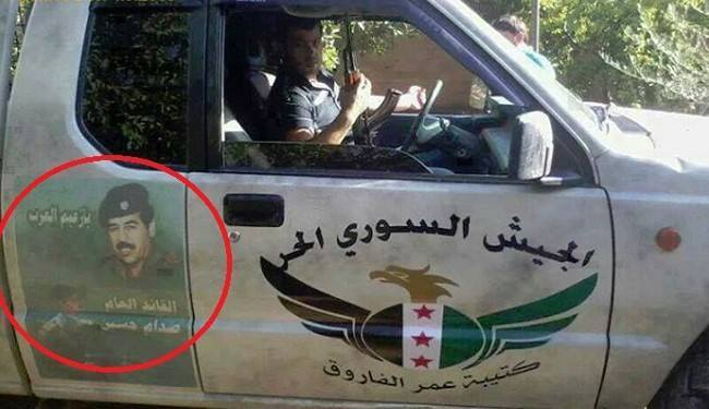 Syrian rebels are now posting Saddam Hussein's picture on their trucks