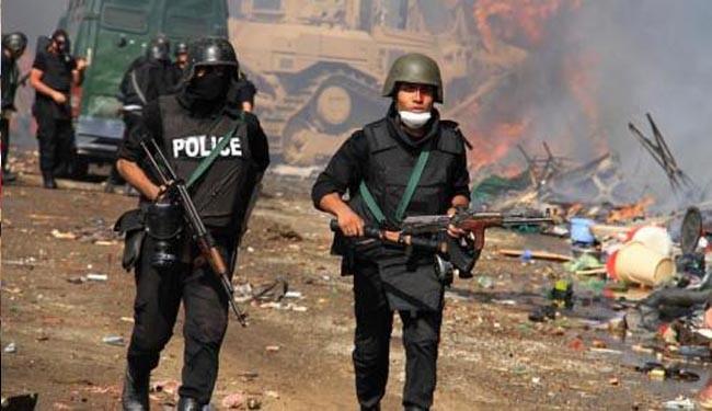 Egypt police raid area near Cairo, one killed