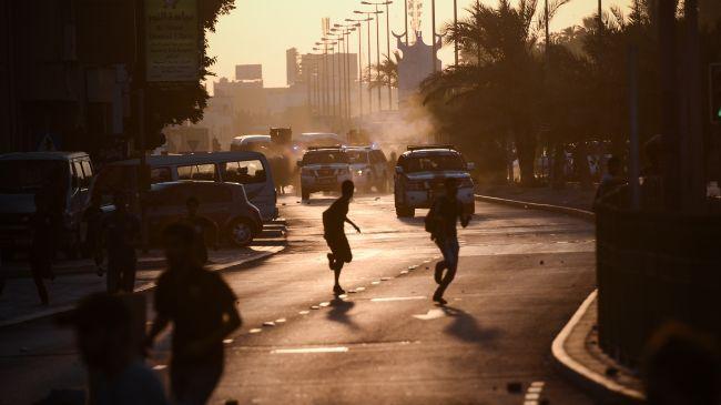 329180_Bahrain-Demonstrators-Cover