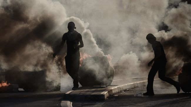Photo of Zionist-puppet Bahrain police disperse protesters