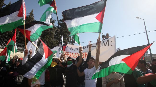 Photo of Palestinians protest at Kerry's visit