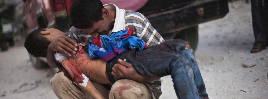 Handout photo of a Syrian man crying while holding the body of his son near Dar El Shifa hospital in Aleppo, Syria