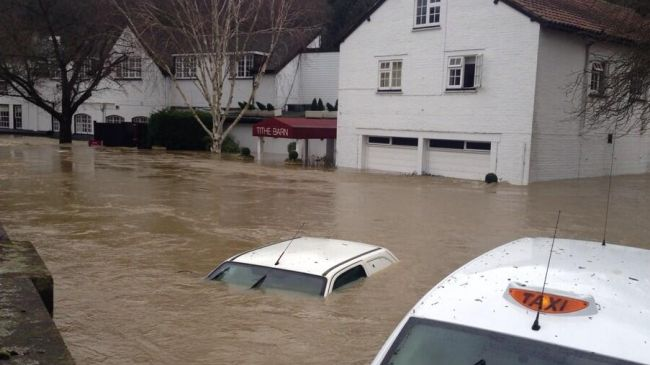 Photo of UK torrential rains kill two, leave over 100K without power