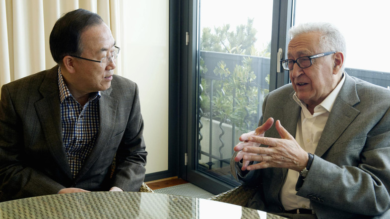 U.N. chief Ban Ki-moon and Syria mediator Lakhdar Brahimi speak during a meeting in Mont Pelerin