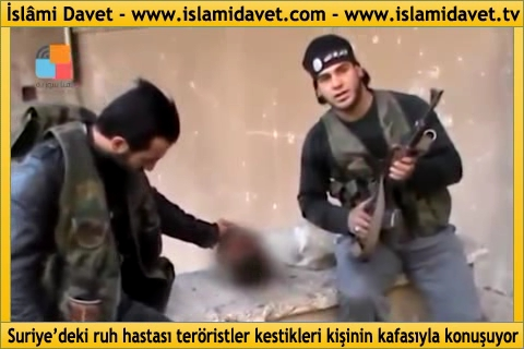 Photo of Video- Psychopath terrorists in Syria talking with the beheaded body
