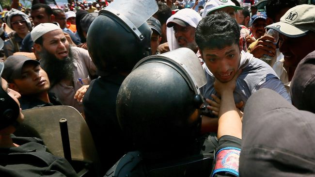 Photo of Police clash with Morsi fans in Egypt