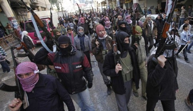 Photo of Syrian terrorists battle al-Qaeda-linked terrorists