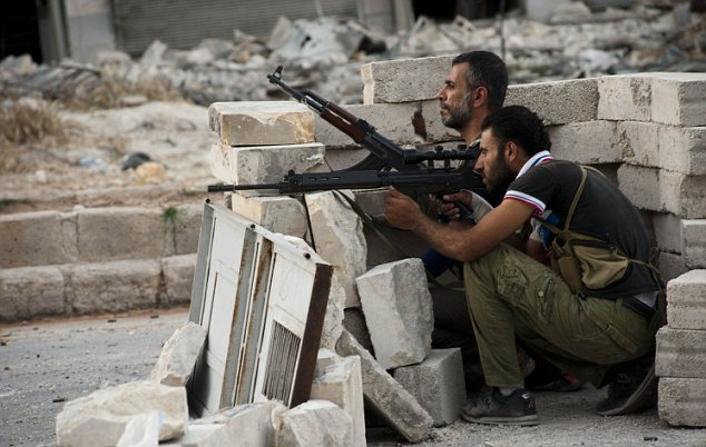 Free Syrian Army fighters exchange fire
