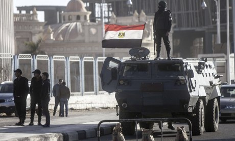 Egyptian riot police stand guard outside location of Mohamed Morsi trial in Cairo