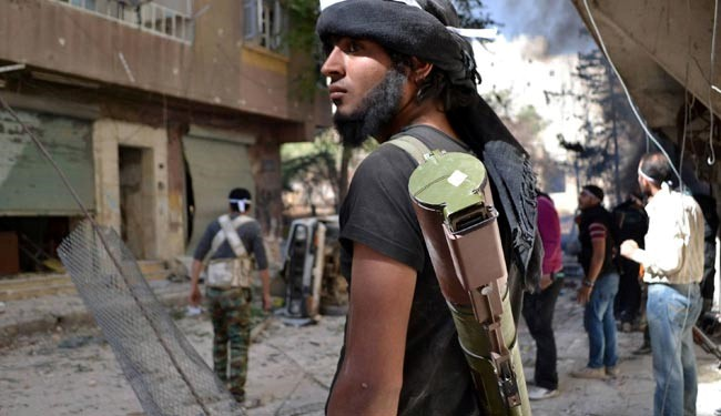 ISIL publically beheads 2 men with sword in Syria's Raqqa