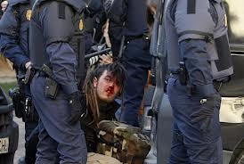 Photo of Police clash with Spanish protesters in Madrid