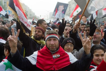 Photo of Syrians hold demos in support of government, army