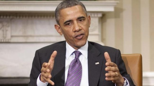Photo of Obama threatens Syrian president with more pressure