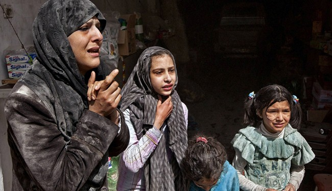 First civilians leave besieged part of Syria's Homs
