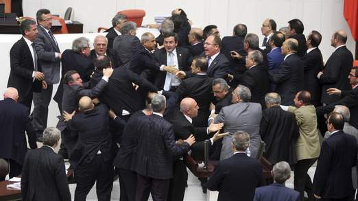 Members of parliament from the ruling AK Party and the main opposition Republican People's Party scuffle in Ankara