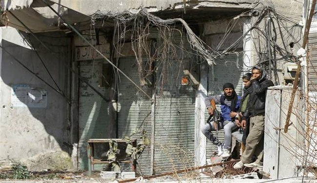 Syria army, militants agree to call local truce in Damascus area