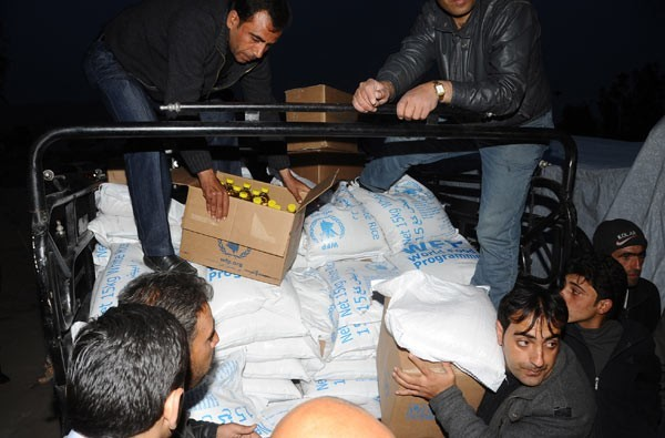 Photo of Humanitarian aid distributed to displaced families in Hasaka and Damascus Countryside
