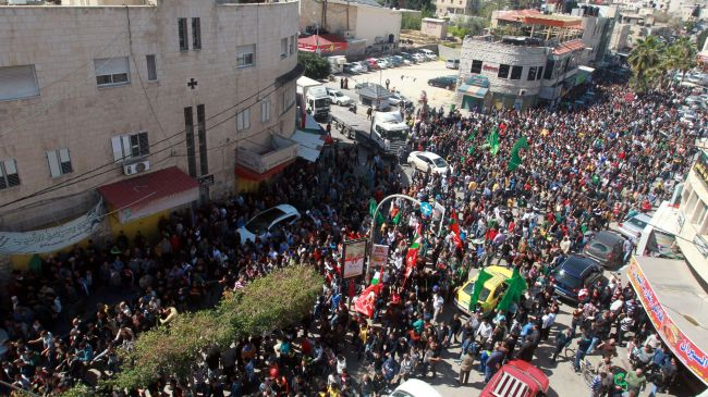 Photo of Palestinians killed by zionist Israel laid to rest