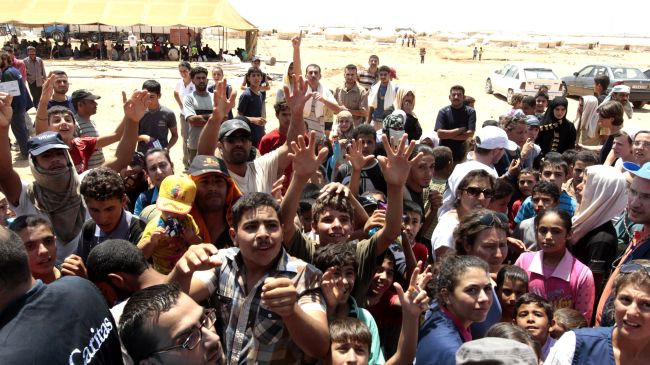 Photo of Syrian refugees clash with Jordanian police at refugee camp