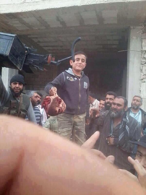 Photo of NATO, UN-backed terrorists in Syria made a child hold head of a Syrians