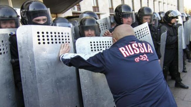 Kiev accuses Russia of being behind protests